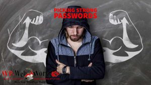 strong passwords concept - man wearing hoodie with strong muscled arms drawn on blackboard behind him
