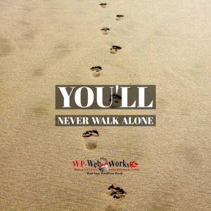 footprints in the sand - concept: you'll never walk alone